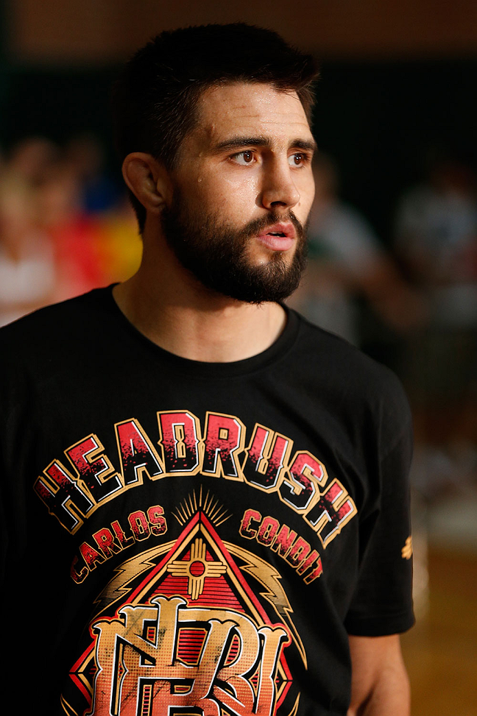 INDIANAPOLIS, IN - AUGUST 26:  Carlos Condit holds an open training session for fans and media at Banker's Life Fieldhouse on August 26, 2013 in Indianapolis, Indiana. (Photo by Josh Hedges/Zuffa LLC/Zuffa LLC via Getty Images)