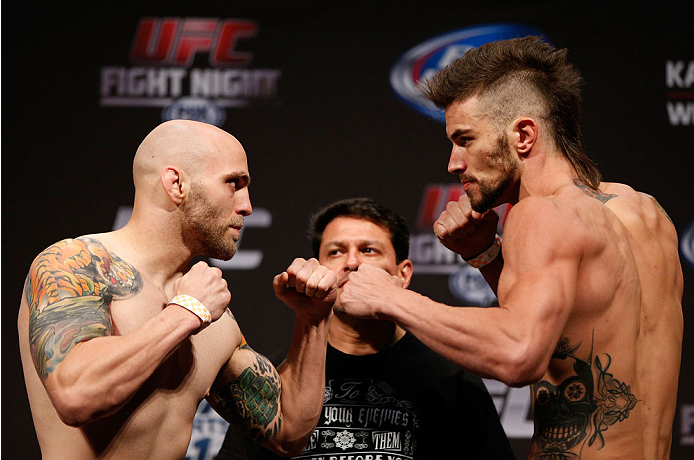 INDIANAPOLIS, IN - AUGUST 27:  (L-R) Opponents Justin Edwards and Brandon Thatch face off during the UFC weigh-in event at Bankers Life Fieldhouse on August 27, 2013 in Indianapolis, Indiana. (Photo by Josh Hedges/Zuffa LLC/Zuffa LLC via Getty Images)