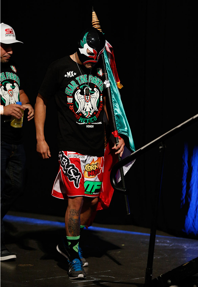 INDIANAPOLIS, IN - AUGUST 27:  Erik Perez enters the arena during UFC weigh-in event at Bankers Life Fieldhouse on August 27, 2013 in Indianapolis, Indiana. (Photo by Josh Hedges/Zuffa LLC/Zuffa LLC via Getty Images)