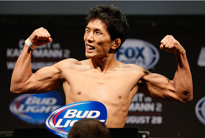 INDIANAPOLIS, IN - AUGUST 27:  Takeya Mizugaki weighs in during the UFC weigh-in event at Bankers Life Fieldhouse on August 27, 2013 in Indianapolis, Indiana. (Photo by Josh Hedges/Zuffa LLC/Zuffa LLC via Getty Images)