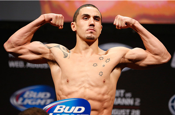INDIANAPOLIS, IN - AUGUST 27:  Robert Whittaker weighs in during the UFC weigh-in event at Bankers Life Fieldhouse on August 27, 2013 in Indianapolis, Indiana. (Photo by Josh Hedges/Zuffa LLC/Zuffa LLC via Getty Images)