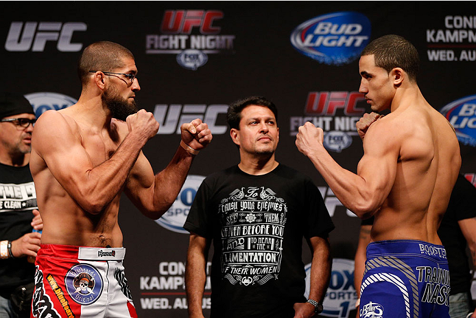 INDIANAPOLIS, IN - AUGUST 27:  (L-R) Opponents Court McGee and Robert Whittaker face off during the UFC weigh-in event at Bankers Life Fieldhouse on August 27, 2013 in Indianapolis, Indiana. (Photo by Josh Hedges/Zuffa LLC/Zuffa LLC via Getty Images)