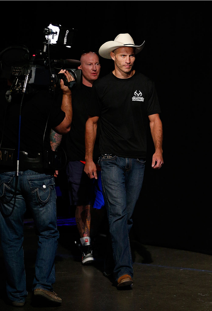 "INDIANAPOLIS, IN - AUGUST 27:  Donald ""Cowboy"" Cerrone enters the arena during the UFC weigh-in event at Bankers Life Fieldhouse on August 27, 2013 in Indianapolis, Indiana. (Photo by Josh Hedges/Zuffa LLC/Zuffa LLC via Getty Images)"