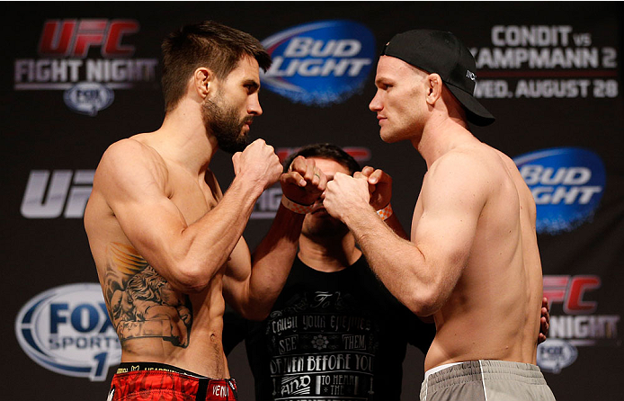 INDIANAPOLIS, IN - AUGUST 27:  (L-R) Opponents Carlos Condit and Martin Kampmann face off during the UFC weigh-in event at Bankers Life Fieldhouse on August 27, 2013 in Indianapolis, Indiana. (Photo by Josh Hedges/Zuffa LLC/Zuffa LLC via Getty Images)