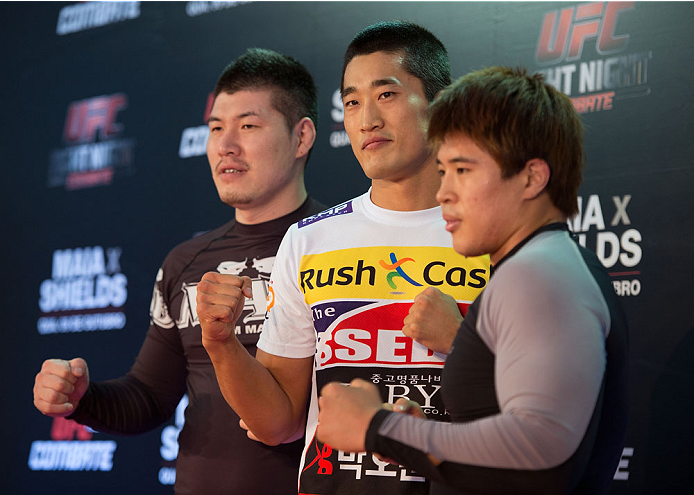 BARUERI, BRAZIL - OCTOBER 7:  Dong Hyun Kim (center) and training team pose during an open training session for media at the Ginasio Jose Correa on October 7, 2013 in Barueri, Sao Paulo, Brazil. (Photo by Jeff Bottari/Zuffa LLC/Zuffa LLC via Getty Images) *** Local Caption *** Dong Hyun Kim