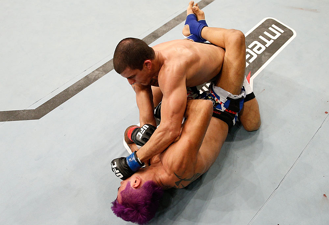 "FORTALEZA, BRAZIL - JUNE 08:  Felipe Arantes (top) punches Godofredo ""Pepey"" Castro in their featherweight fight during the UFC on FUEL TV event at Paulo Sarasate Arena on June 8, 2013 in Fortaleza, Ceara, Brazil.  (Photo by Josh Hedges/Zuffa LLC/Zuffa LLC via Getty Images)"