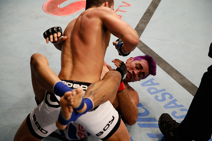 "FORTALEZA, BRAZIL - JUNE 08:  Felipe Arantes (top) elbows Godofredo ""Pepey"" Castro in their featherweight fight during the UFC on FUEL TV event at Paulo Sarasate Arena on June 8, 2013 in Fortaleza, Ceara, Brazil.  (Photo by Josh Hedges/Zuffa LLC/Zuffa LLC via Getty Images)"