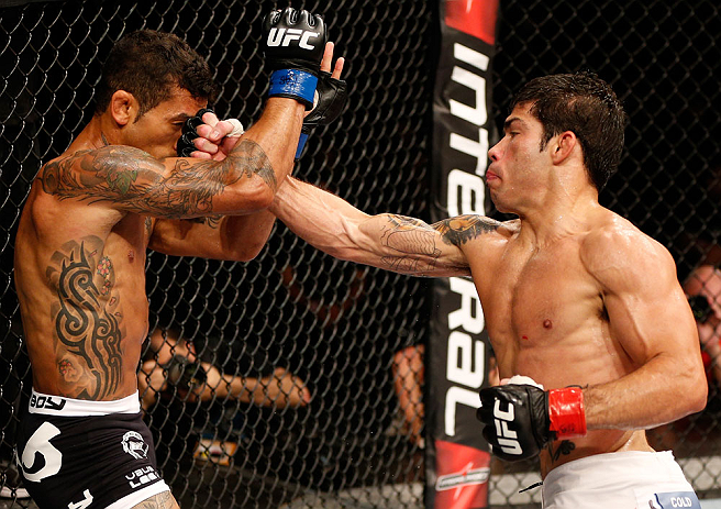 FORTALEZA, BRAZIL - JUNE 08:  (R-L) Raphael Assuncao punches Vaughan Lee in their bantamweight fight during the UFC on FUEL TV event at Paulo Sarasate Arena on June 8, 2013 in Fortaleza, Ceara, Brazil.  (Photo by Josh Hedges/Zuffa LLC/Zuffa LLC via Getty Images)