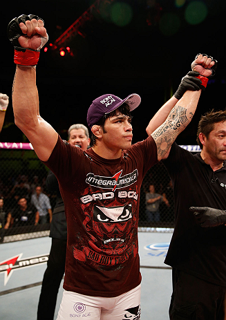 FORTALEZA, BRAZIL - JUNE 08:  Erick Silva reacts after defeating Jason High in their welterweight fight during the UFC on FUEL TV event at Paulo Sarasate Arena on June 8, 2013 in Fortaleza, Ceara, Brazil.  (Photo by Josh Hedges/Zuffa LLC/Zuffa LLC via Getty Images)