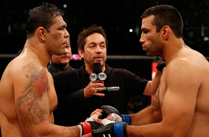 "FORTALEZA, BRAZIL - JUNE 08:  (L-R) Opponents Antonio Rodrigo ""Minotauro"" Nogueira and Fabricio Werdum face off before their heavyweight fight during the UFC on FUEL TV event at Paulo Sarasate Arena on June 8, 2013 in Fortaleza, Ceara, Brazil.  (Photo by Josh Hedges/Zuffa LLC/Zuffa LLC via Getty Images)"