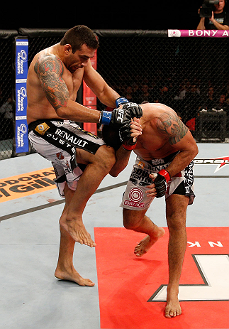 "FORTALEZA, BRAZIL - JUNE 08:  (L-R) Fabricio Werdum knees Antonio Rodrigo ""Minotauro"" Nogueira in their heavyweight fight during the UFC on FUEL TV event at Paulo Sarasate Arena on June 8, 2013 in Fortaleza, Ceara, Brazil.  (Photo by Josh Hedges/Zuffa LLC/Zuffa LLC via Getty Images)"