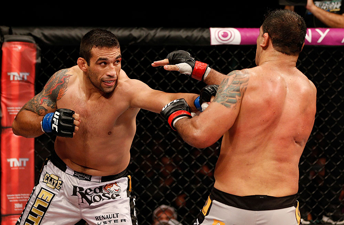 "FORTALEZA, BRAZIL - JUNE 08:  (L-R) Fabricio Werdum punches Antonio Rodrigo ""Minotauro"" Nogueira in their heavyweight fight during the UFC on FUEL TV event at Paulo Sarasate Arena on June 8, 2013 in Fortaleza, Ceara, Brazil.  (Photo by Josh Hedges/Zuffa LLC/Zuffa LLC via Getty Images)"