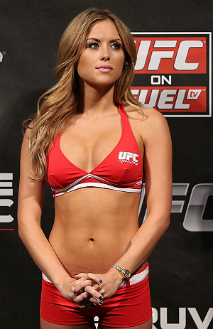 NOTTINGHAM, ENGLAND - SEPTEMBER 28:  UFC Octagon Girl Brittney Palmer stands on stage during the UFC on Fuel TV weigh in at Capital FM Arena on September 28, 2012 in Nottingham, England.  (Photo by Josh Hedges/Zuffa LLC/Zuffa LLC via Getty Images)