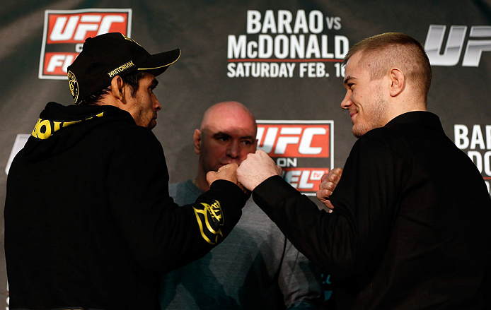 LONDON, ENGLAND - FEBRUARY 13:  (L-R) Opponents Renan Barao and Michael McDonald face off during a UFC press conference on February 13, 2013 at Hooks Gym in London, England.  (Photo by Josh Hedges/Zuffa LLC/Zuffa LLC via Getty Images)