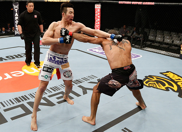 SAITAMA, JAPAN - MARCH 03:  (L-R) Hyun Gyu Lim and Marcelo Guimaraes trade punches in their welterweight fight during the UFC on FUEL TV event at Saitama Super Arena on March 3, 2013 in Saitama, Japan.  (Photo by Josh Hedges/Zuffa LLC/Zuffa LLC via Getty Images)