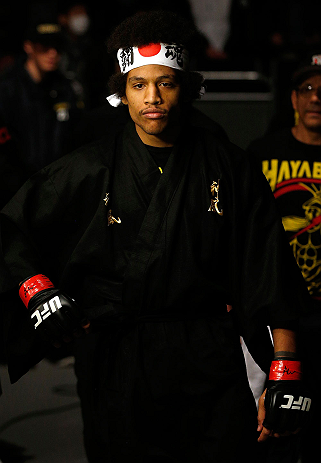 SAITAMA, JAPAN - MARCH 03:  Alex Caceres enters the arena before his bantamweight fight against Kyung Ho Kang during the UFC on FUEL TV event at Saitama Super Arena on March 3, 2013 in Saitama, Japan.  (Photo by Josh Hedges/Zuffa LLC/Zuffa LLC via Getty Images)