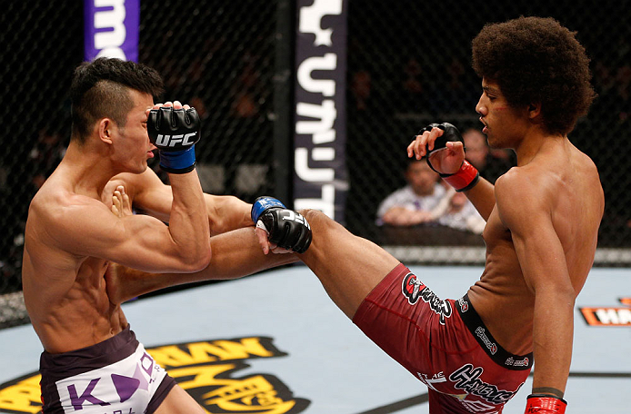 SAITAMA, JAPAN - MARCH 03:  (R-L) Alex Caceres kicks Kyung Ho Kang in their bantamweight fight during the UFC on FUEL TV event at Saitama Super Arena on March 3, 2013 in Saitama, Japan.  (Photo by Josh Hedges/Zuffa LLC/Zuffa LLC via Getty Images)