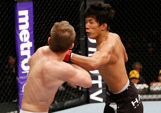 SAITAMA, JAPAN - MARCH 03:  (R-L) Takeya Mizugaki punches Bryan Caraway in their bantamweight fight during the UFC on FUEL TV event at Saitama Super Arena on March 3, 2013 in Saitama, Japan.  (Photo by Josh Hedges/Zuffa LLC/Zuffa LLC via Getty Images)