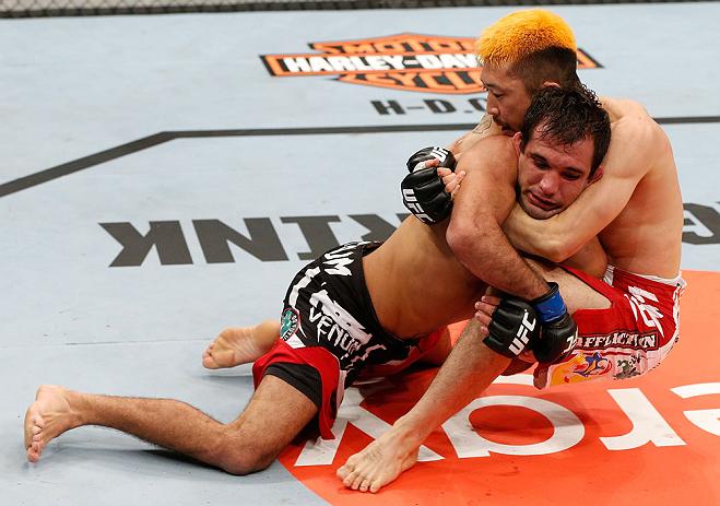 SAITAMA, JAPAN - MARCH 03:  (L-R) Rani Yahya takes down Mizuto Hirota in their featherweight fight during the UFC on FUEL TV event at Saitama Super Arena on March 3, 2013 in Saitama, Japan.  (Photo by Josh Hedges/Zuffa LLC/Zuffa LLC via Getty Images)