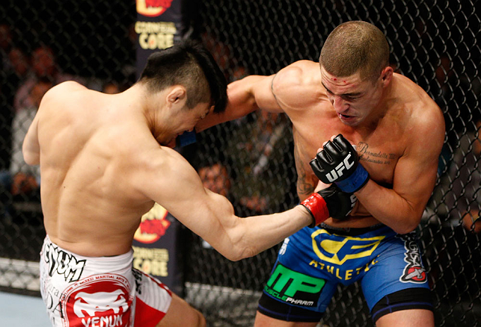 SAITAMA, JAPAN - MARCH 03:  (L-R) Takanori Gomi and Diego Sanchez trade punches in their lightweight fight during the UFC on FUEL TV event at Saitama Super Arena on March 3, 2013 in Saitama, Japan.  (Photo by Josh Hedges/Zuffa LLC/Zuffa LLC via Getty Images)