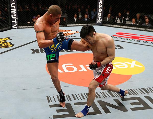 SAITAMA, JAPAN - MARCH 03:  (L-R) Diego Sanchez kicks Takanori Gomi in their lightweight fight during the UFC on FUEL TV event at Saitama Super Arena on March 3, 2013 in Saitama, Japan.  (Photo by Josh Hedges/Zuffa LLC/Zuffa LLC via Getty Images)