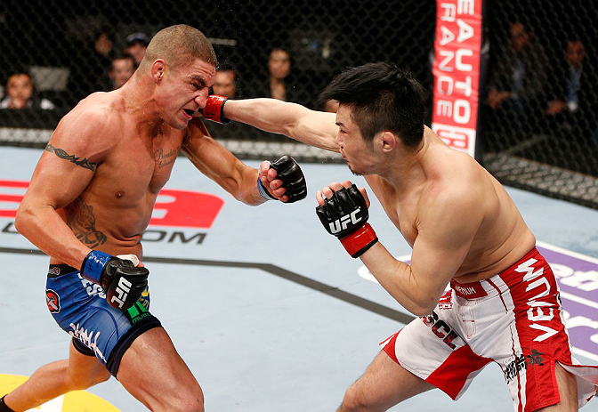 SAITAMA, JAPAN - MARCH 03:  (R-L) Takanori Gomi punches Diego Sanchez in their lightweight fight during the UFC on FUEL TV event at Saitama Super Arena on March 3, 2013 in Saitama, Japan.  (Photo by Josh Hedges/Zuffa LLC/Zuffa LLC via Getty Images)