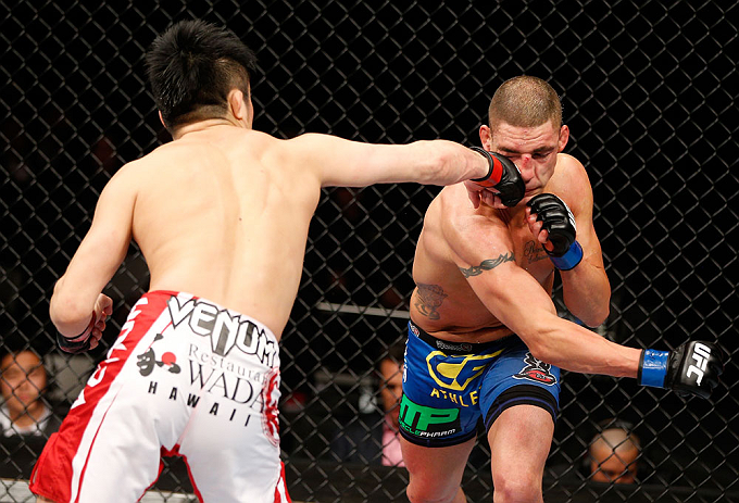 SAITAMA, JAPAN - MARCH 03:  (L-R) Takanori Gomi punches Diego Sanchez in their lightweight fight during the UFC on FUEL TV event at Saitama Super Arena on March 3, 2013 in Saitama, Japan.  (Photo by Josh Hedges/Zuffa LLC/Zuffa LLC via Getty Images)