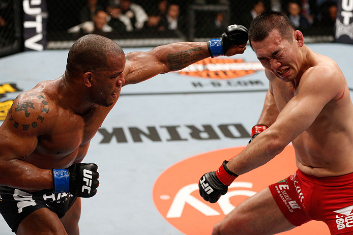 SAITAMA, JAPAN - MARCH 03:  (L-R) Hector Lombard punches Yushin Okami in their middleweight fight during the UFC on FUEL TV event at Saitama Super Arena on March 3, 2013 in Saitama, Japan.  (Photo by Josh Hedges/Zuffa LLC/Zuffa LLC via Getty Images)
