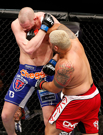 SAITAMA, JAPAN - MARCH 03:  (R-L) Mark Hunt punches Stefan Struve in their heavyweight fight during the UFC on FUEL TV event at Saitama Super Arena on March 3, 2013 in Saitama, Japan.  (Photo by Josh Hedges/Zuffa LLC/Zuffa LLC via Getty Images)