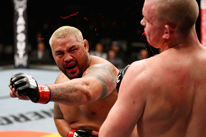SAITAMA, JAPAN - MARCH 03:  (L-R) Mark Hunt knocks out Stefan Struve with a punch in their heavyweight fight during the UFC on FUEL TV event at Saitama Super Arena on March 3, 2013 in Saitama, Japan.  (Photo by Josh Hedges/Zuffa LLC/Zuffa LLC via Getty Images)