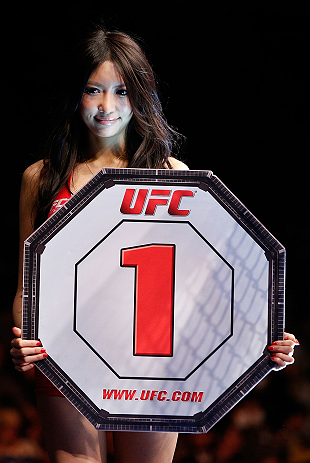 SAITAMA, JAPAN - MARCH 03:  UFC Octagon Girl Azusa Nishigaki introduces a round during the UFC on FUEL TV event at Saitama Super Arena on March 3, 2013 in Saitama, Japan.  (Photo by Josh Hedges/Zuffa LLC/Zuffa LLC via Getty Images)