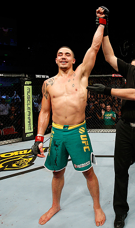GOLD COAST, AUSTRALIA - DECEMBER 15:  Robert Whittaker reacts after defeating Bradley Scott during their welterweight fight at the UFC on FX event on December 15, 2012  at Gold Coast Convention and Exhibition Centre in Gold Coast, Australia.  (Photo by Josh Hedges/Zuffa LLC/Zuffa LLC via Getty Images)