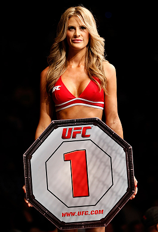 GOLD COAST, AUSTRALIA - DECEMBER 15:  UFC Octagon Girl Kristie McKeon introduces a round during the UFC on FX event on December 15, 2012  at Gold Coast Convention and Exhibition Centre in Gold Coast, Australia.  (Photo by Josh Hedges/Zuffa LLC/Zuffa LLC via Getty Images)