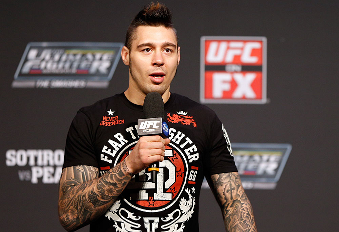 GOLD COAST, AUSTRALIA - DECEMBER 14:  UFC welterweight fighter Dan Hardy interacts with fans during a Q&A session before the UFC on FX weigh in on December 14, 2012 at Gold Coast Convention and Exhibition Centre in Gold Coast, Queensland, Australia.  (Photo by Josh Hedges/Zuffa LLC/Zuffa LLC via Getty Images)