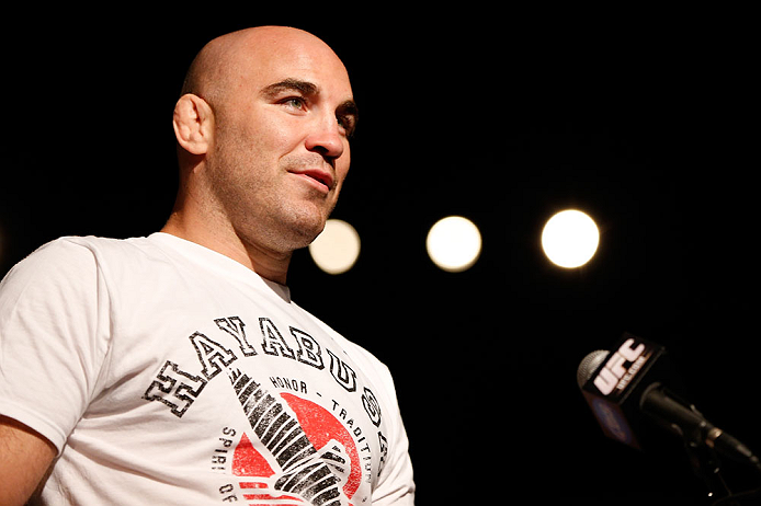 GOLD COAST, AUSTRALIA - DECEMBER 14:  Fellow UFC fighter Brian Ebersole asks a question of Dan Hardy during a Q&A session before the UFC on FX weigh in on December 14, 2012 at Gold Coast Convention and Exhibition Centre in Gold Coast, Queensland, Australia.  (Photo by Josh Hedges/Zuffa LLC/Zuffa LLC via Getty Images)