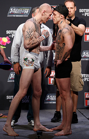 GOLD COAST, AUSTRALIA - DECEMBER 14:  (L-R) Opponents Colin Fletcher and Norman Parke face off during the UFC on FX weigh in on December 14, 2012 at Gold Coast Convention and Exhibition Centre in Gold Coast, Queensland, Australia.  (Photo by Josh Hedges/Zuffa LLC/Zuffa LLC via Getty Images)