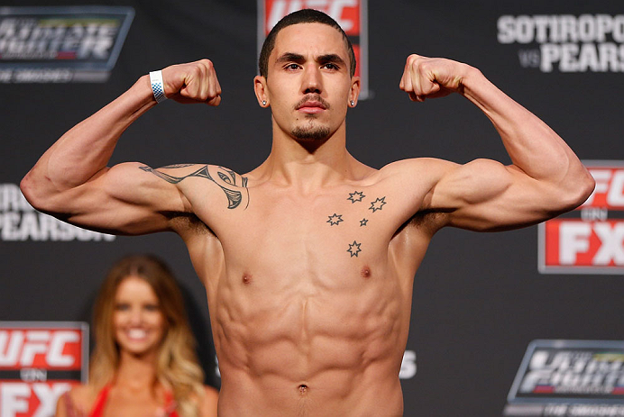 GOLD COAST, AUSTRALIA - DECEMBER 14:  Robert Whittaker weighs in during the UFC on FX weigh in on December 14, 2012 at Gold Coast Convention and Exhibition Centre in Gold Coast, Queensland, Australia.  (Photo by Josh Hedges/Zuffa LLC/Zuffa LLC via Getty Images)