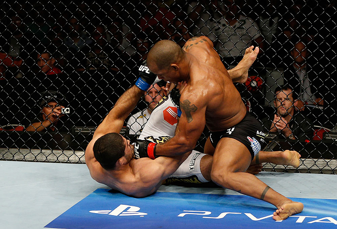 GOLD COAST, AUSTRALIA - DECEMBER 15:  (R-L) Hector Lombard punches Rousimar Palhares during their middleweight fight at the UFC on FX event on December 15, 2012  at Gold Coast Convention and Exhibition Centre in Gold Coast, Australia.  (Photo by Josh Hedges/Zuffa LLC/Zuffa LLC via Getty Images)