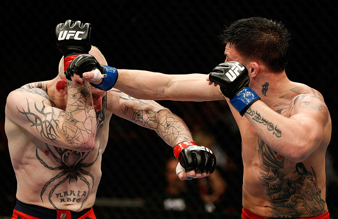 GOLD COAST, AUSTRALIA - DECEMBER 15:  (R-L) Norman Parke punches Colin Fletcher during their lightweight fight at the UFC on FX event on December 15, 2012  at Gold Coast Convention and Exhibition Centre in Gold Coast, Australia.  (Photo by Josh Hedges/Zuffa LLC/Zuffa LLC via Getty Images)