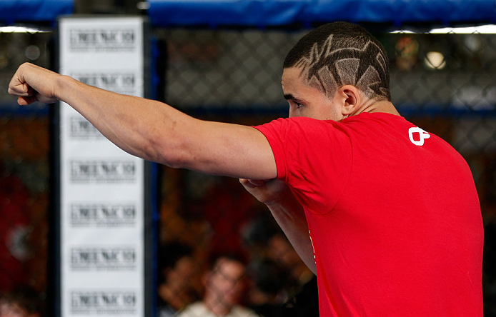 GOLD COAST, AUSTRALIA - DECEMBER 13:  Robert Whittaker works out for the media during the UFC on FX open workouts on December 13, 2012 at Boonchu Gym in Gold Coast, Australia.  (Photo by Josh Hedges/Zuffa LLC/Zuffa LLC via Getty Images)