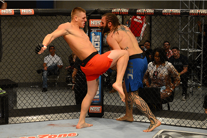 LAS VEGAS, NV - OCTOBER 16:  (L-R) Anton Berzin lands a knee to the body of Cody Mumma in their elimination fight during filming of season nineteen of The Ultimate Fighter on October 16, 2013 in Las Vegas, Nevada. (Photo by Al Powers/Zuffa LLC/Zuffa LLC via Getty Images) *** Local Caption *** Anton Berzin; Cody Mumma