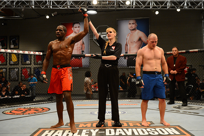LAS VEGAS, NV - OCTOBER 16:  (L-R) Corey Anderson celebrates after defeating Kelly Anundson in their elimination fight during filming of season nineteen of The Ultimate Fighter on October 16, 2013 in Las Vegas, Nevada. (Photo by Al Powers/Zuffa LLC/Zuffa LLC via Getty Images) *** Local Caption *** Corey Anderson; Kelly Anundson