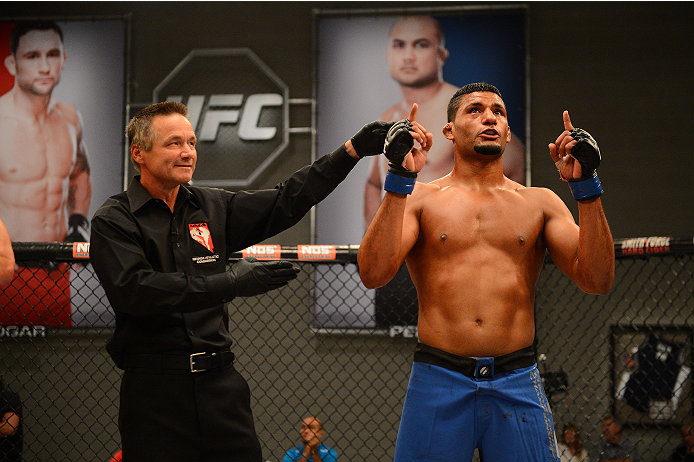 LAS VEGAS, NV - OCTOBER 16:  (R-L) Dhiego Lima celebrates after defeating Adam Stroup in their elimination fight during filming of season nineteen of The Ultimate Fighter on October 16, 2013 in Las Vegas, Nevada. (Photo by Al Powers/Zuffa LLC/Zuffa LLC via Getty Images) *** Local Caption *** Dhiego Lima