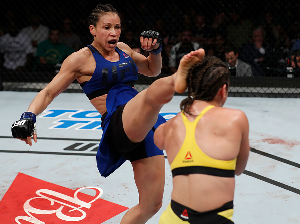 Reneau kicks <a href='../fighter/Bethe-Correia'>Bethe Correia</a> during their bout in March