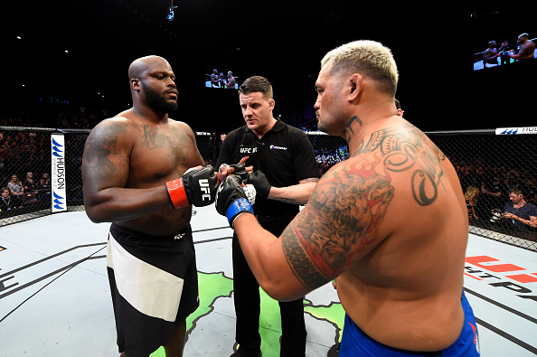 AUCKLAND, NEW ZEALAND - JUNE 11:  (L-R) Derrick Lewis and Mark Hunt of New Zealand touch gloves before their heavyweight fight during the UFC Fight Night event at the Spark Arena on June 11, 2017 in Auckland, New Zealand. (Photo by Josh Hedges/Zuffa LLC/Zuffa LLC via Getty Images)