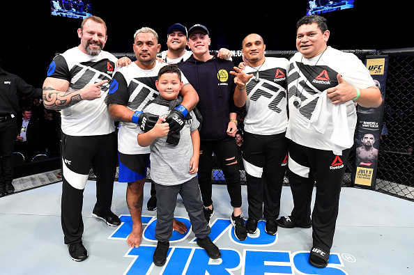 AUCKLAND, NEW ZEALAND - JUNE 11:  Mark Hunt of New Zealand celebrates with his family and corner after defeating Derrick Lewis in their heavyweight fight during the UFC Fight Night event at the Spark Arena on June 11, 2017 in Auckland, New Zealand. (Photo by Josh Hedges/Zuffa LLC/Zuffa LLC via Getty Images)