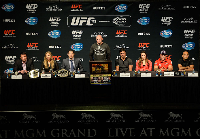 LAS VEGAS, NV - MAY 23:  (L-R) Chael Sonnen, UFC Women's Bantamweight Champion Ronda Rousey, UFC Middleweight Champion Chris Weidman, UFC President Dana White, Lyoto Machida, Alexis Davis, Wanderlei Silva and BJ Penn speak to the media during the UFC 175 & The Ultimate Fighter Finale On-Sale Press Conference at the MGM Grand Garden Arena on May 23, 2014 in Las Vegas, Nevada. (Photo by Jeff Bottari/Zuffa LLC/Zuffa LLC via Getty Images)
