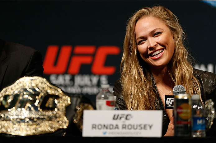 LAS VEGAS, NV - MAY 23:  UFC women's bantamweight champion Ronda Rousey interacts with media and fans during the UFC press conference at the MGM Grand Garden Arena on May 23, 2014 in Las Vegas, Nevada.  (Photo by Josh Hedges/Zuffa LLC/Zuffa LLC via Getty Images)