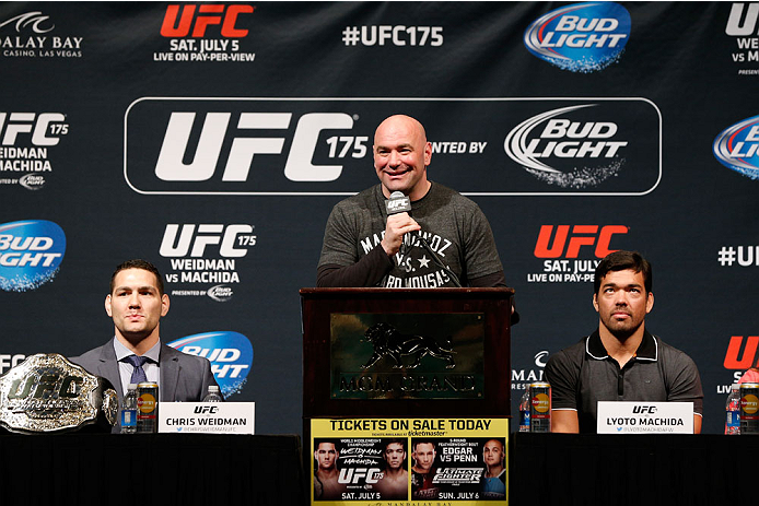 LAS VEGAS, NV - MAY 23:  (L-R) UFC middleweight champion Chris Weidman, UFC president Dana White, and middleweight title challenger Lyoto Machida of Brazil are seen on stage during the UFC press conference at the MGM Grand Garden Arena on May 23, 2014 in Las Vegas, Nevada.  (Photo by Josh Hedges/Zuffa LLC/Zuffa LLC via Getty Images)