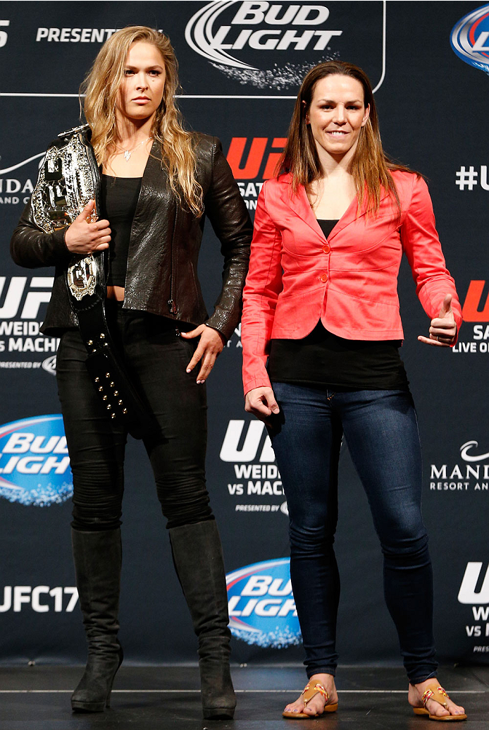 LAS VEGAS, NV - MAY 23:  (L-R) Opponents Ronda Rousey and Alexis Davis pose for photos during the UFC press conference at the MGM Grand Garden Arena on May 23, 2014 in Las Vegas, Nevada.  (Photo by Josh Hedges/Zuffa LLC/Zuffa LLC via Getty Images)